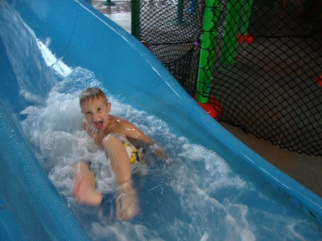 picture of Happy boy at the bottom of the waterslide!
