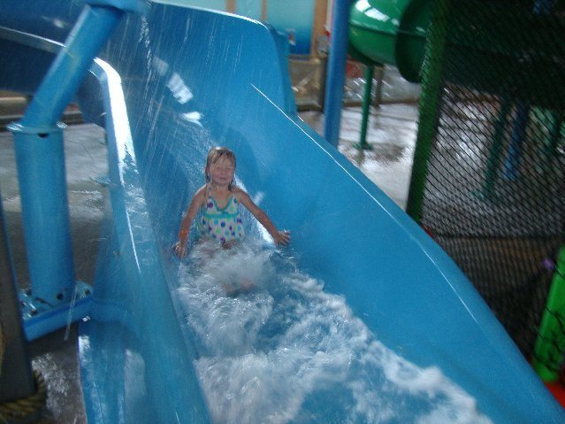 picture of Eliabeth coming down the waterslide and through spraying water
