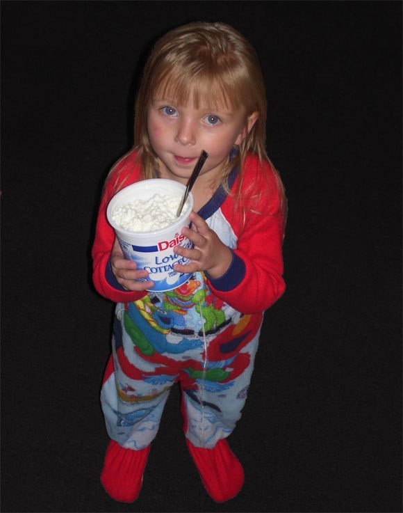 Child holding Daisy Cottage Cheese