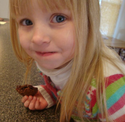 picture of Happy girl eating best chocolate cookie ever!