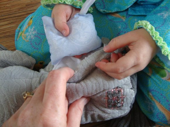 picture of Inserting scent pak into Scentsy Ollie Elephant