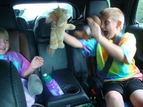 picture of Kids playing in Ford Explorer 2nd row