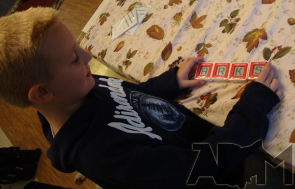 picture of Playing Electronic Scrabble Flash by ThinkGeek.com