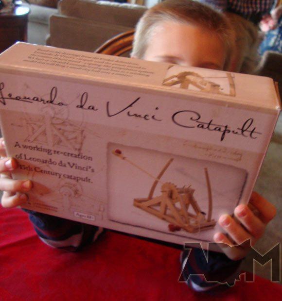 Boy holding box with Leonardo Catapult Kit