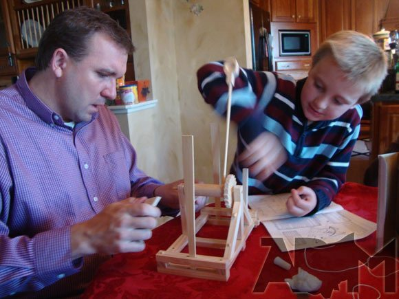 Father and Son Building a Kit