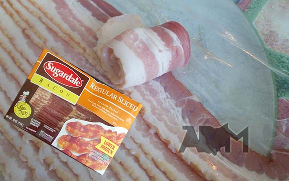 Rolling Up Regular Pork Bacon on a plate