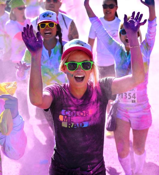 """The Color Me Rad race will hit Akron August 17. Participants are instructed to wear their whitest t-shirt, lace up their shoes, grab their family and friends and prepare to be """"color bombed."""""""