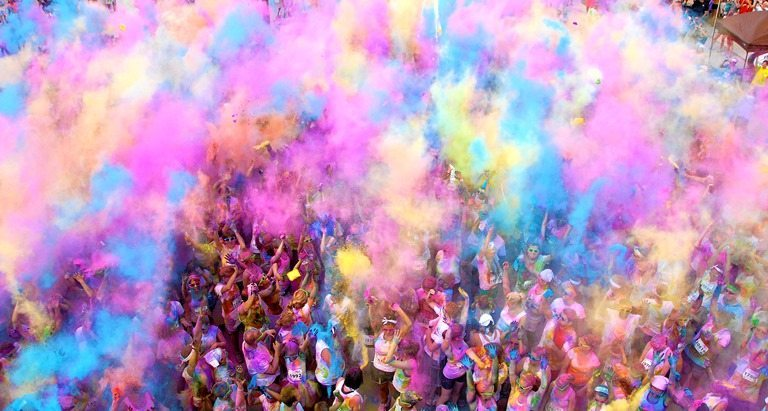 """At the end of the Color Me Rad 5K, each runner will get his/her own color pack to use in a final """"color throw."""" It's like a celebration of running!"""