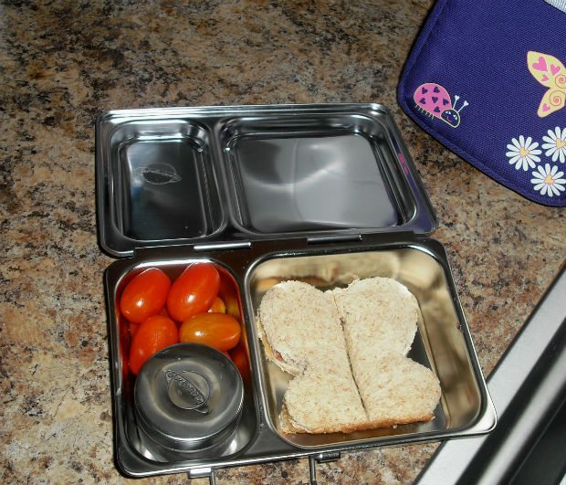 Add a touch of fun with special cutout sandwiches with some veggies and a side of ranch in the tall dipper.