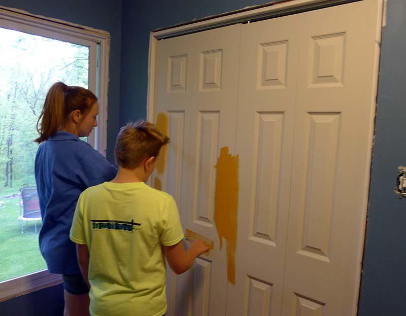 boy-painting-closet-door-orange