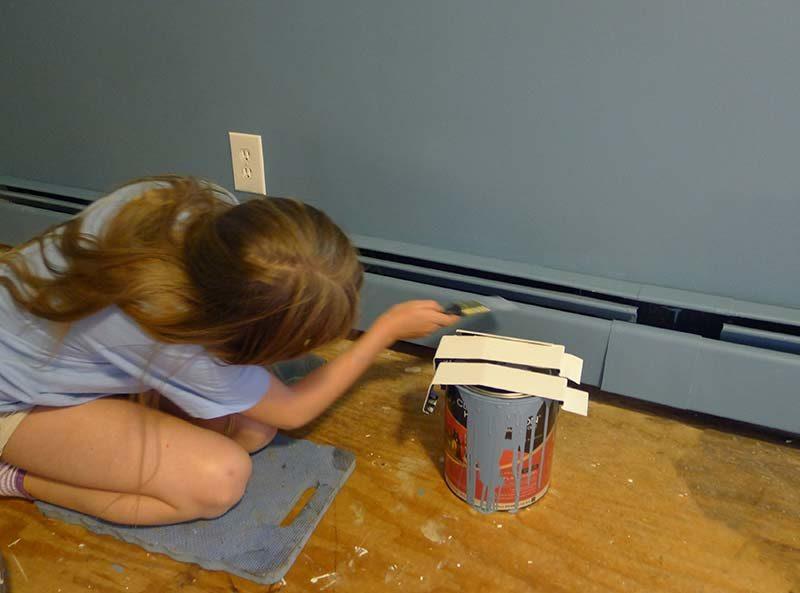 girl-painting-baseboard-heating