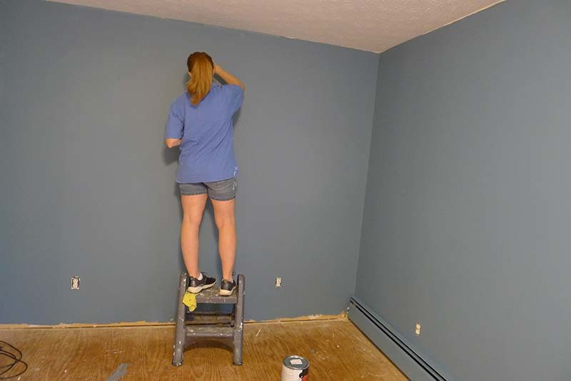 woman-painting-blue-wall