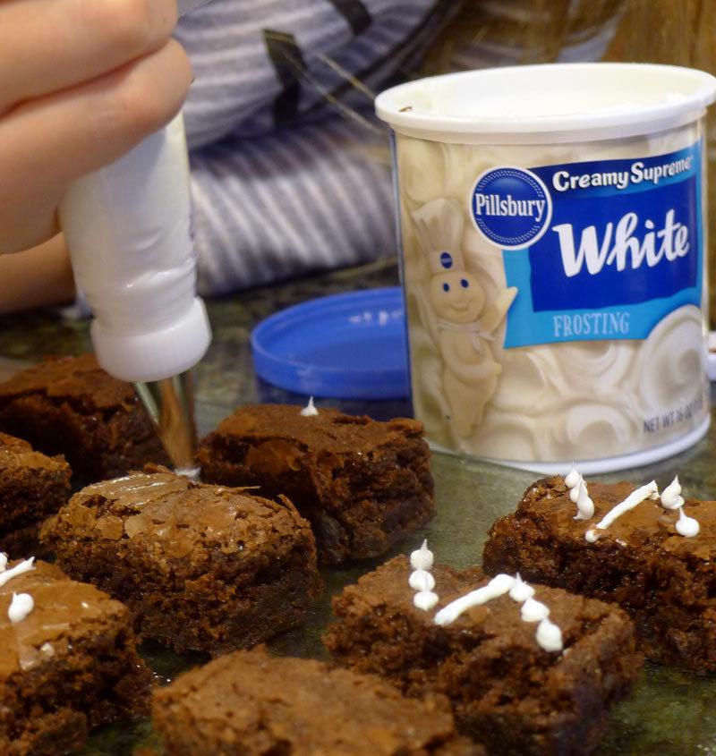 Dominos Brownies using Pillsbury Chocolate Fudge Brownie Mix and White Frosting