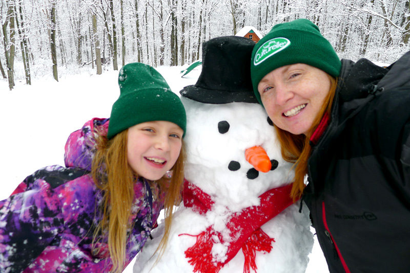 family time play in snow